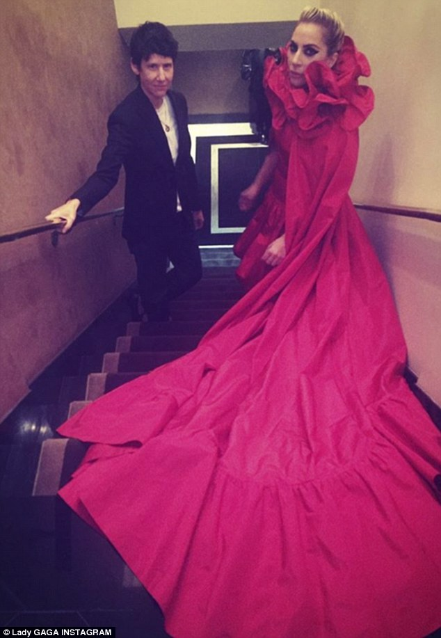 Lady Gaga Poses In A Large Red Frock As She Attends Magazine Party In NYC