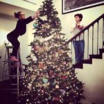 Sharon Osbourne and daughter Kelly Osbourne putting their decs up